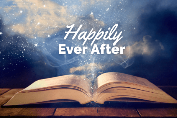 Open bible on a sparkly background with the words happily ever after in bold