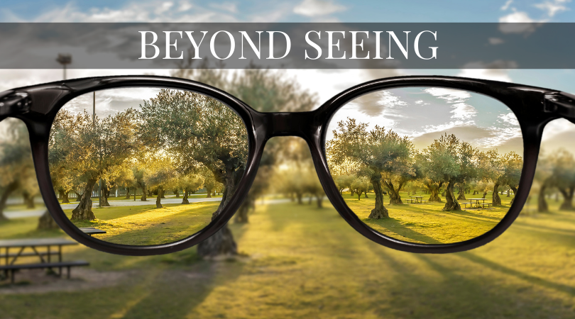 Images of glasses where image of the scenery is only clear through the lenses but the background is blurry.